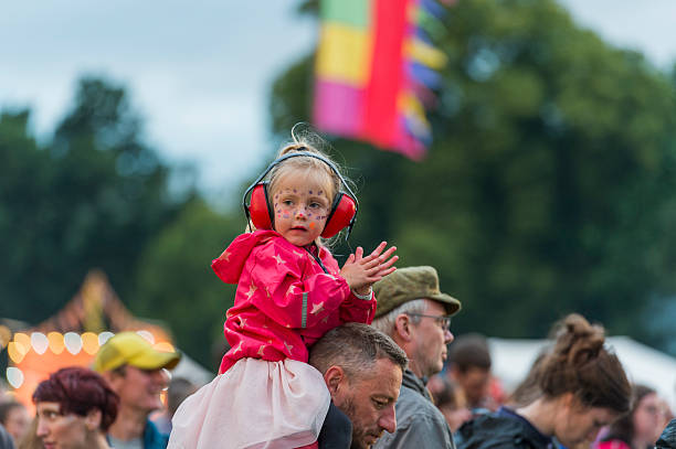 Child wearing ear defenders at a Scottish music festival stock photo