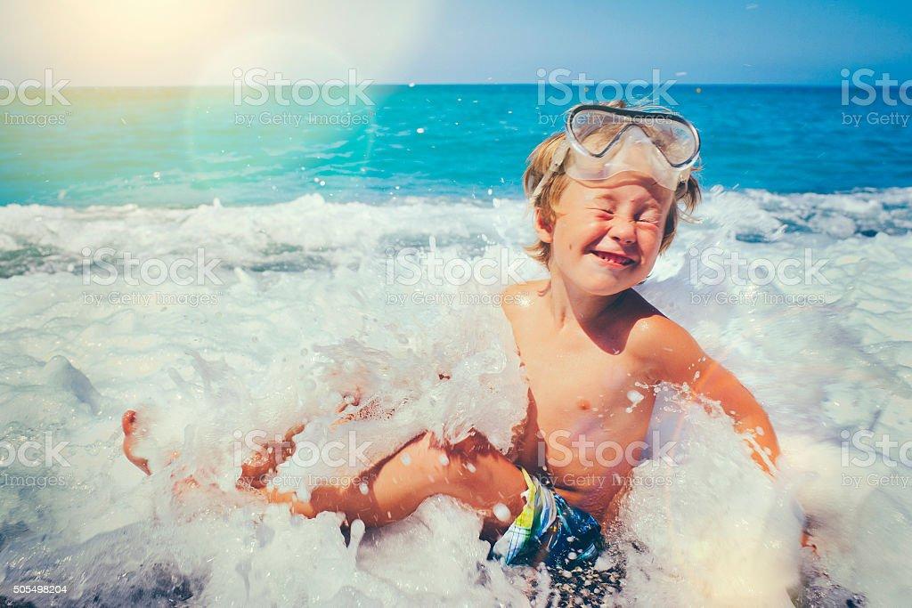 Child wearing scuba mask stock photo