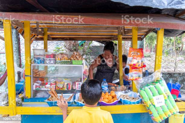 Child who bought a snack at a store palawan philippines dec 222018 picture id1094765720?b=1&k=6&m=1094765720&s=612x612&h=frf4rdvd0ontrluz3bd0oh sljcuohpilanns9jh9xq=