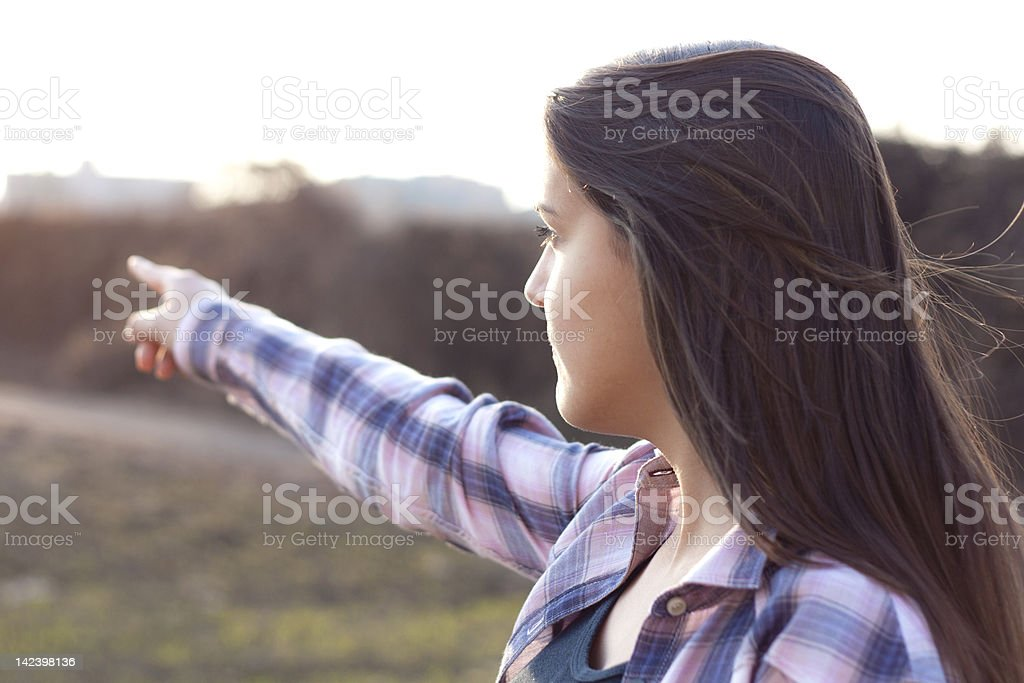 Child who shows a distant point royalty-free stock photo