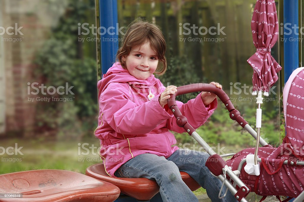 child with a baby carriage royalty-free stock photo