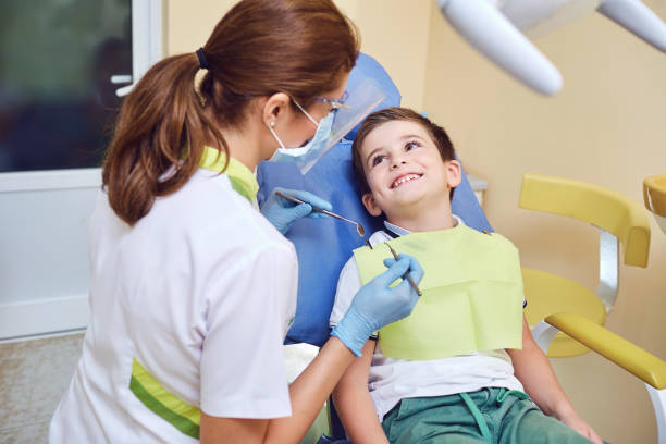 A child with a dentist in a dental office. stock photo