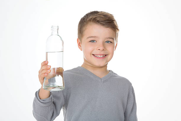 child with a grey t-shirt stock photo