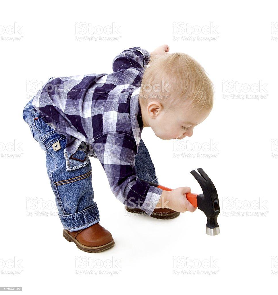 Enfant avec un marteau photo libre de droits