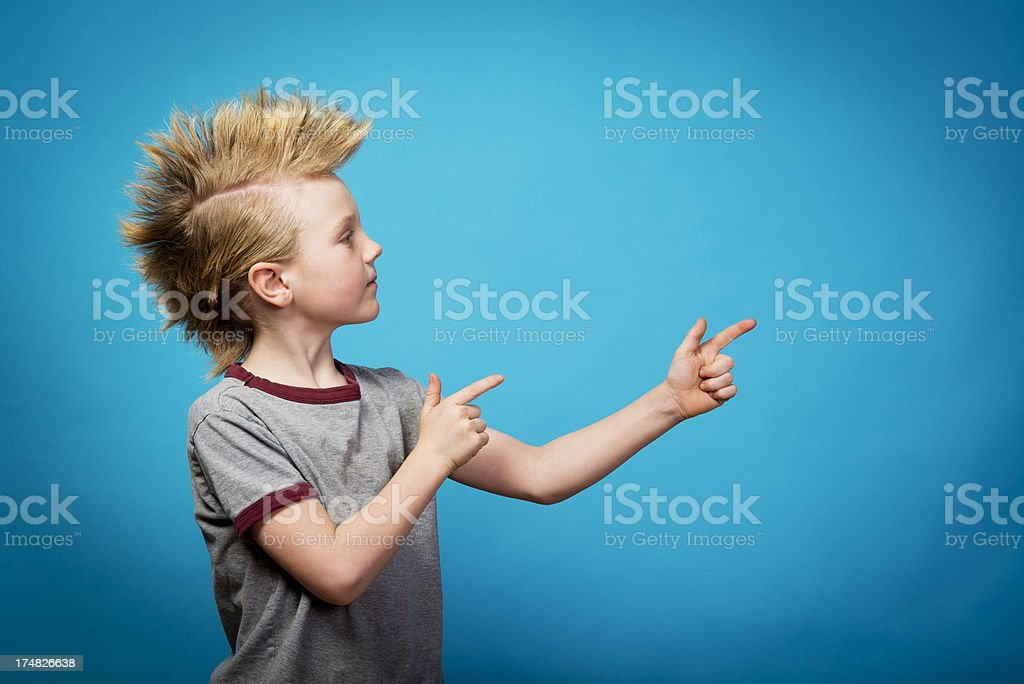 Child with a Mohawk pointing stock photo
