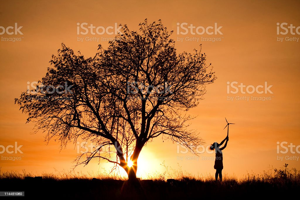 Child with a small wind turbine royalty-free stock photo