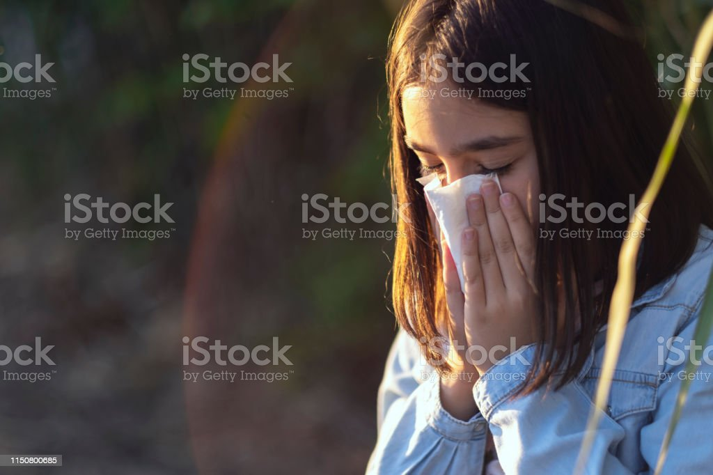 9-10 years. Only one young girl. blowing his nose with handkerchief...