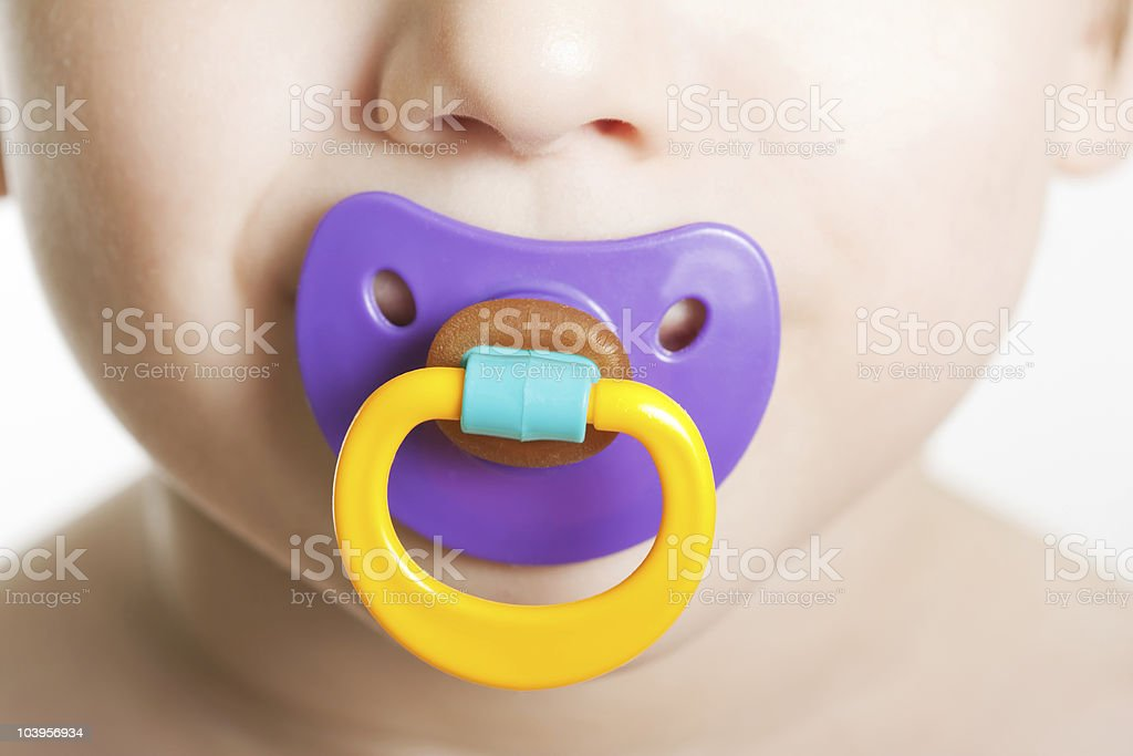 Child with baby pacifier stock photo