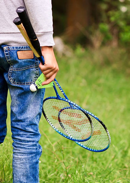 Child with badminton rackets stock photo