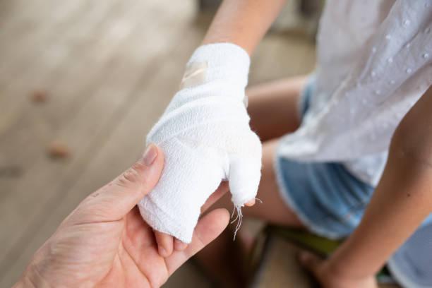 Child with bandage on hand stock photo