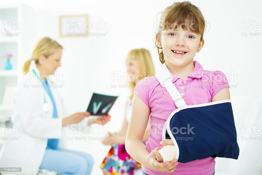 Child with broken arm At Doctors Office. stock photo