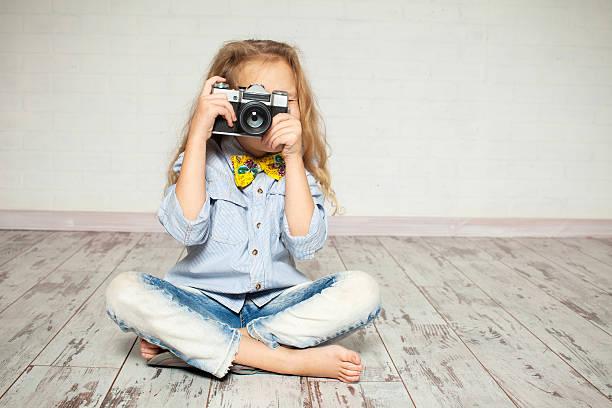 Child with camera. stock photo