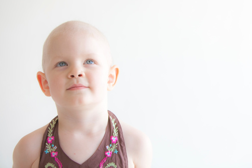Child with cancer headshot looking up
