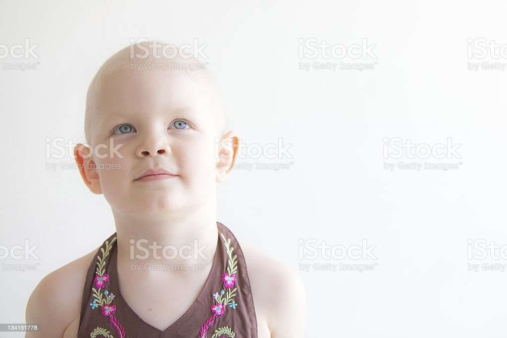 Child with cancer headshot looking up stock photo