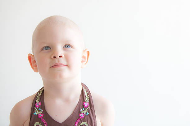 child with cancer headshot looking up - cancer stock photos and pictures