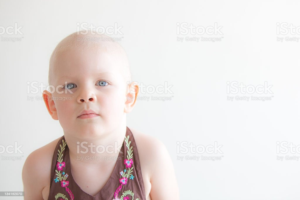 Child with cancer headshot - vacant expression royalty-free stock photo