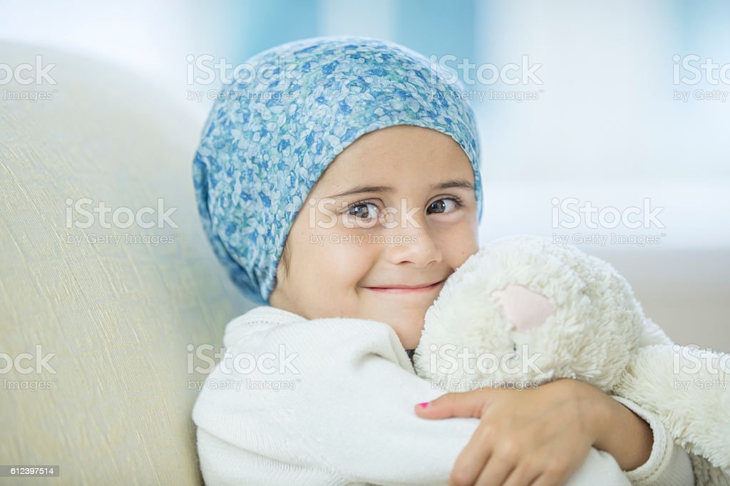 Child with Cancer Hugging Her Stuffed Animal стоковое фото