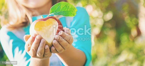 Child with Child with an apple. Selective focus. Garden Food