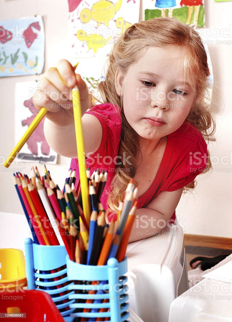 Child  with colour pencil in play room. royalty-free stock photo