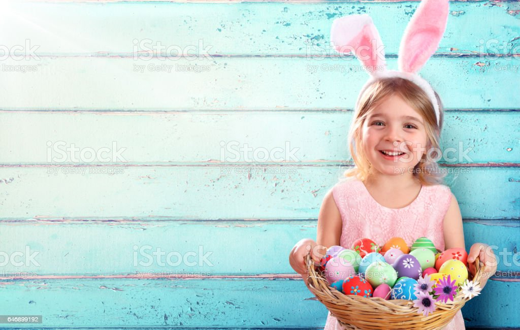 Child With Costume Rabbit Ears And Basket Easter Eggs stock photo