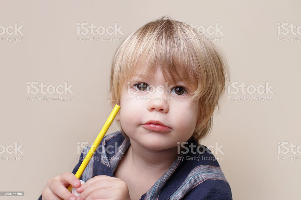 Child with Crayon, Arts stock photo