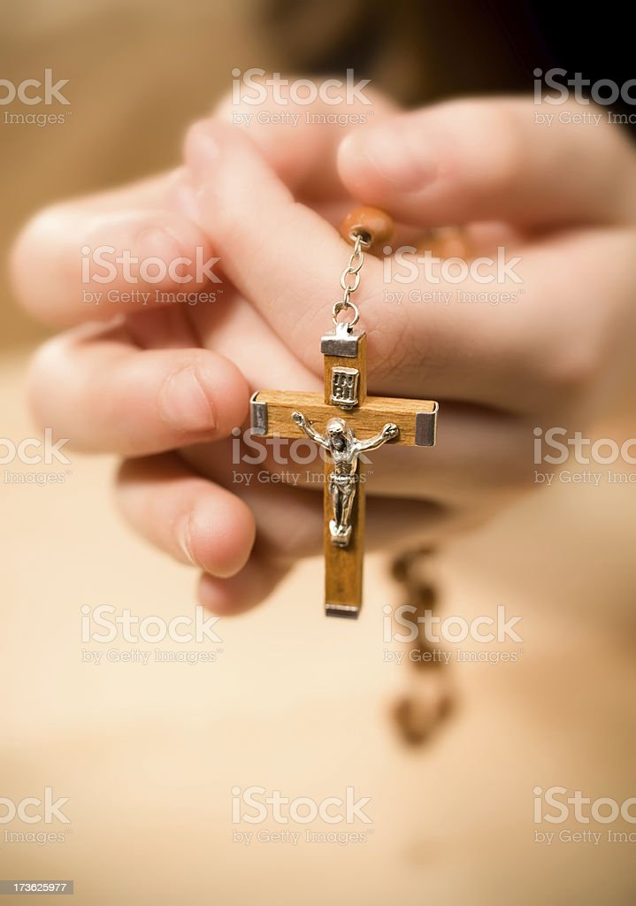 Child with cross stock photo