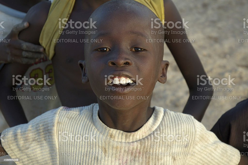 Child with dirty shirt from small village north of Cameroon. stock photo