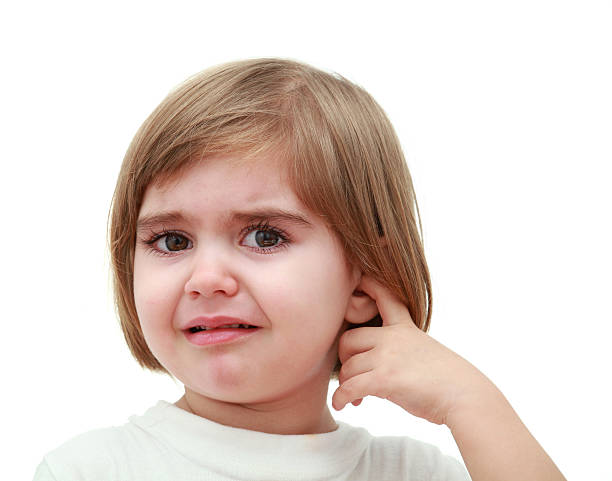 Child with ear pain 3 years old girl crying and holding a finger in the ear human ear stock pictures, royalty-free photos & images