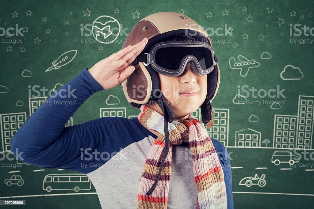 Child with helmet giving respectful gesture royalty-free stock photo