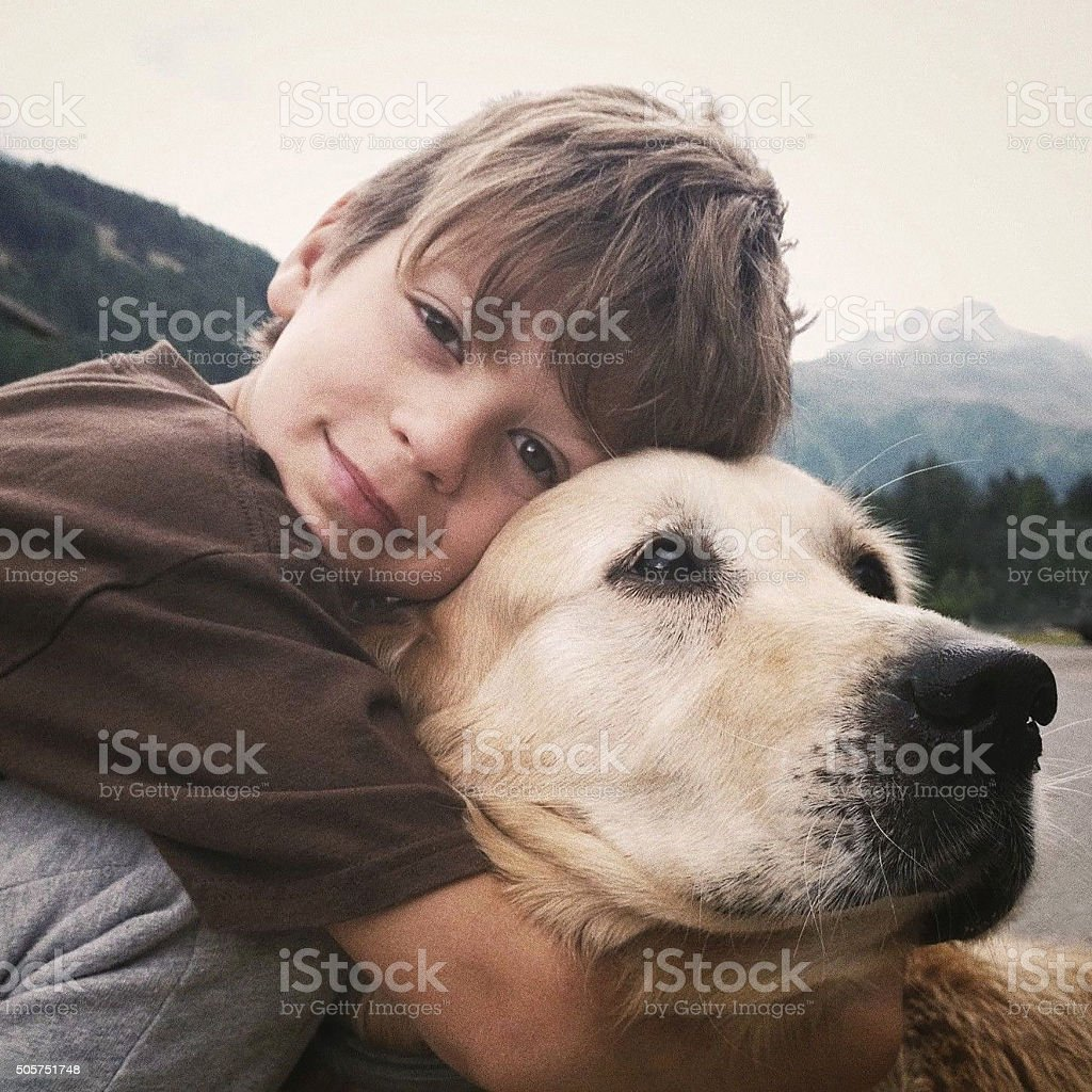 Child with her dog stock photo