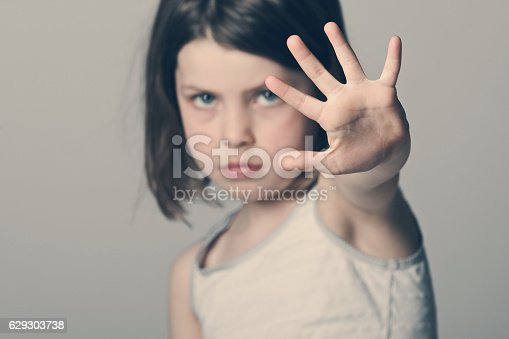 istock Child with her hand up 629303738