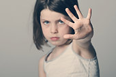 Powerful shot of a child with her hand up