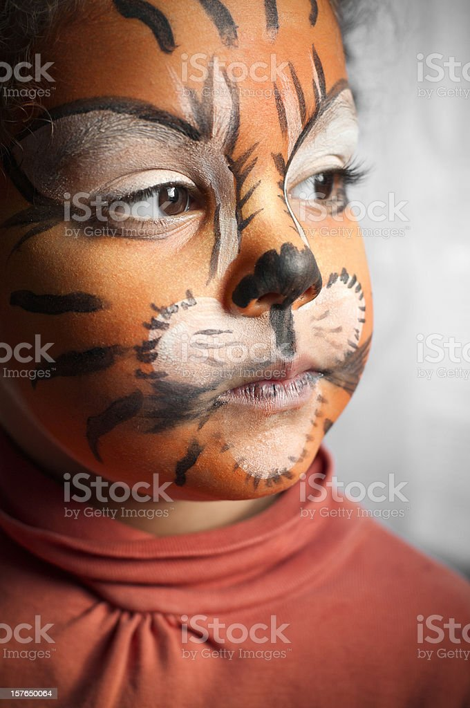 Child with Her Tiger Face Paint, Daydreaming royalty-free stock photo