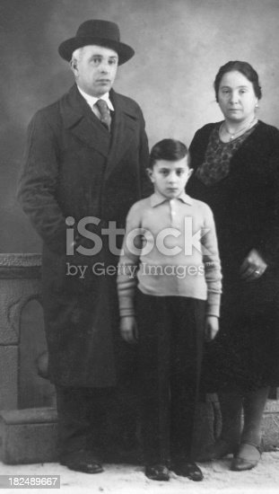 57520540 istock photo Child with his Parents in 1930.Black And White 182489667