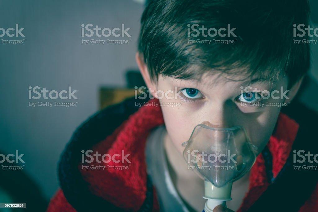 Child with inhalation mask stock photo