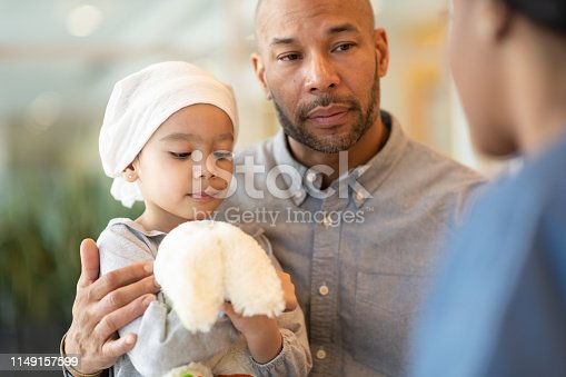 823893962 istock photo Child with leukemia visits the doctor with her father 1149157599