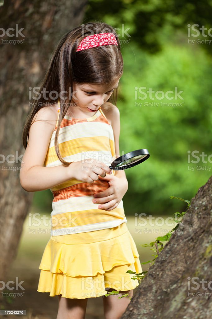Child with loupe royalty-free stock photo