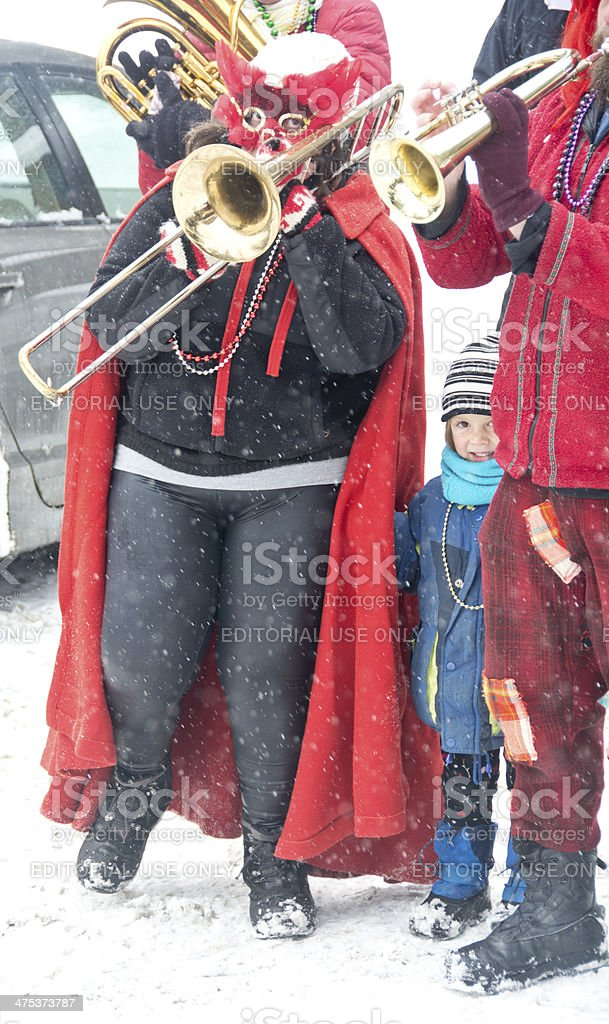Child with Mardi Gras brass band royalty-free stock photo