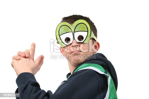 Child with frog mask.