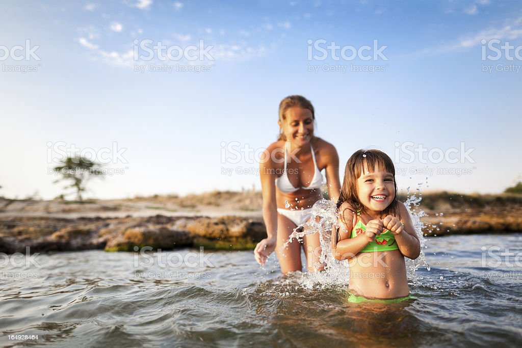 Child with mother at sea royalty-free stock photo