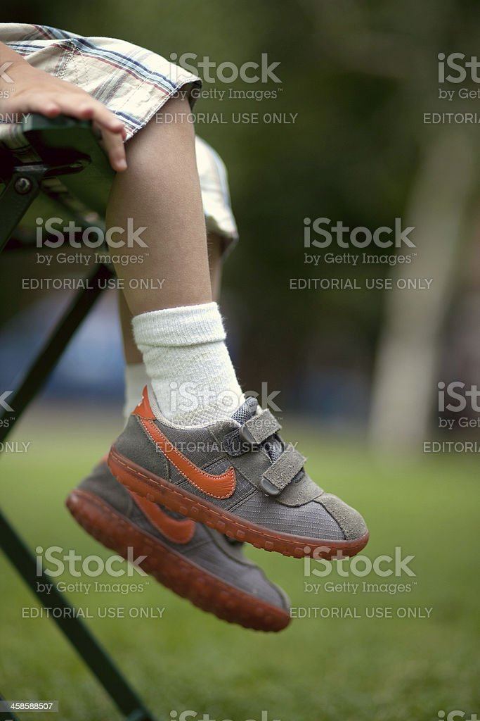 Child with Nike shoes royalty-free stock photo