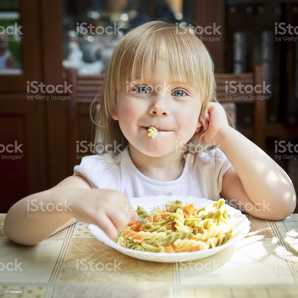 Child with pasta royalty-free stock photo