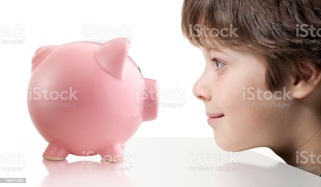 Child with piggy bank royalty-free stock photo