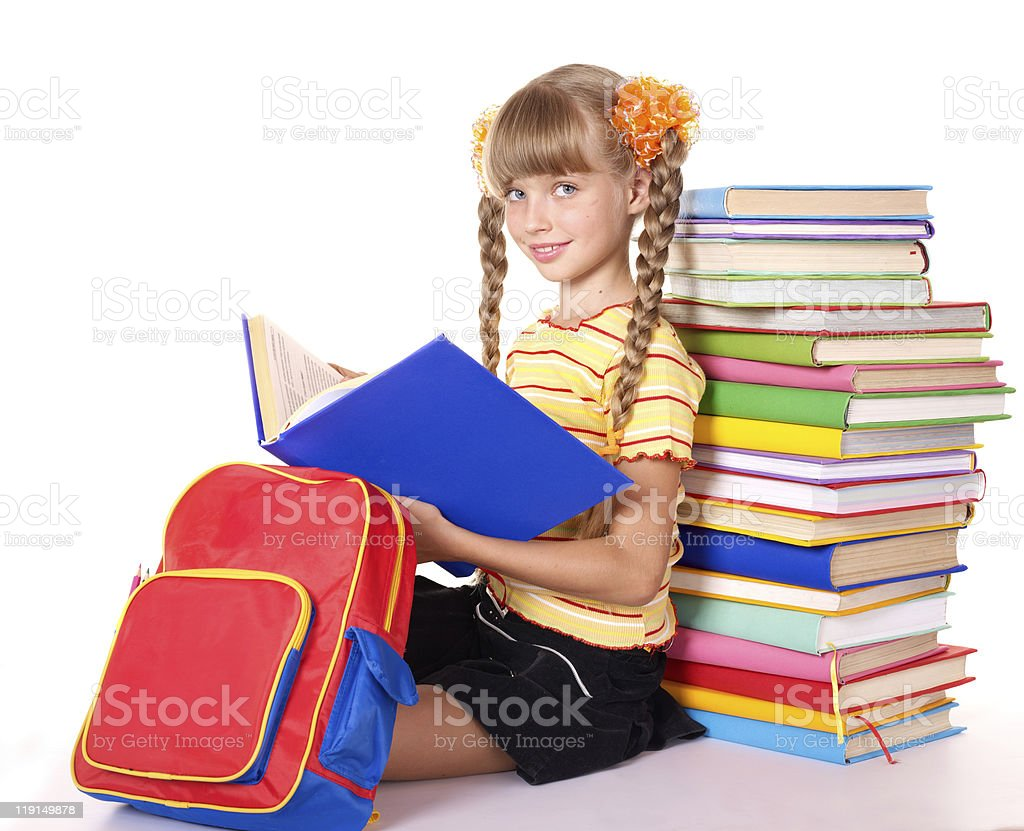 Child with pile of books reading on floor royalty-free stock photo