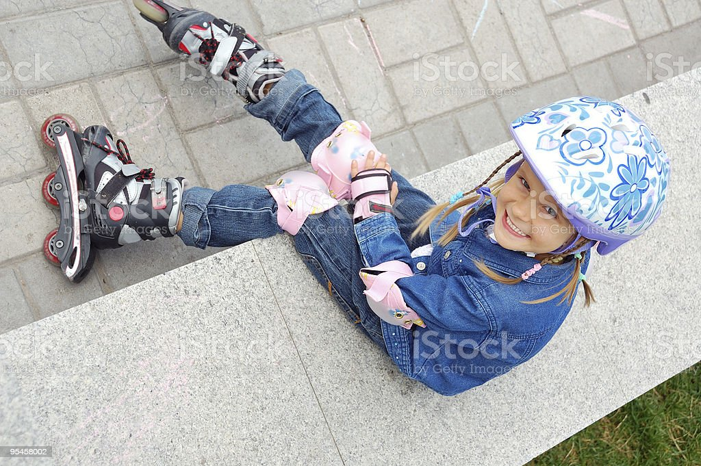 child with rollerskates and  helmet stock photo