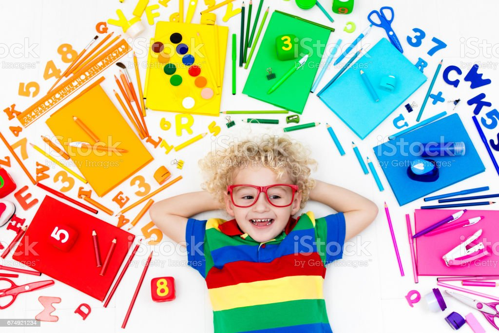 Child with school and drawing supplies. Student with book. royalty-free stock photo