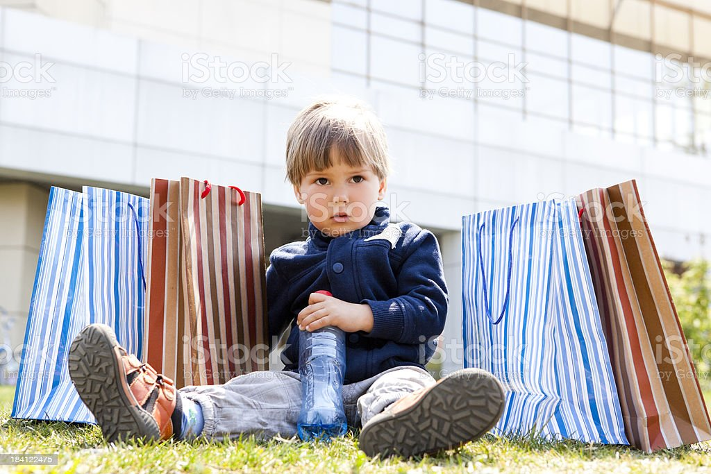 child with shopping bags royalty-free stock photo