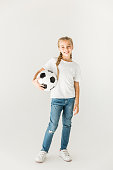 adorable happy child holding soccer ball isolated on white