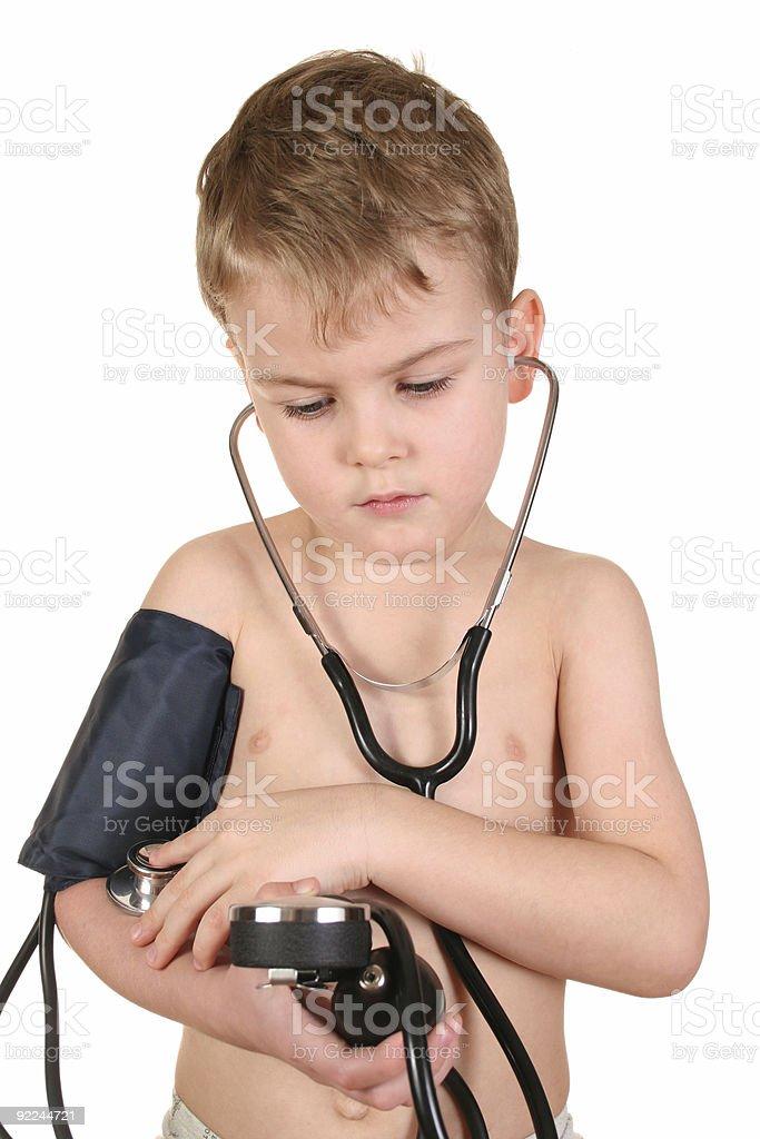 child with sphygmomanometer royalty-free stock photo