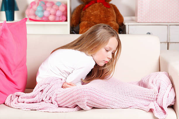 Child with stomach ache stock photo